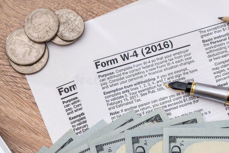 W4 with money. 2017 tax form - w4 with money stock photos