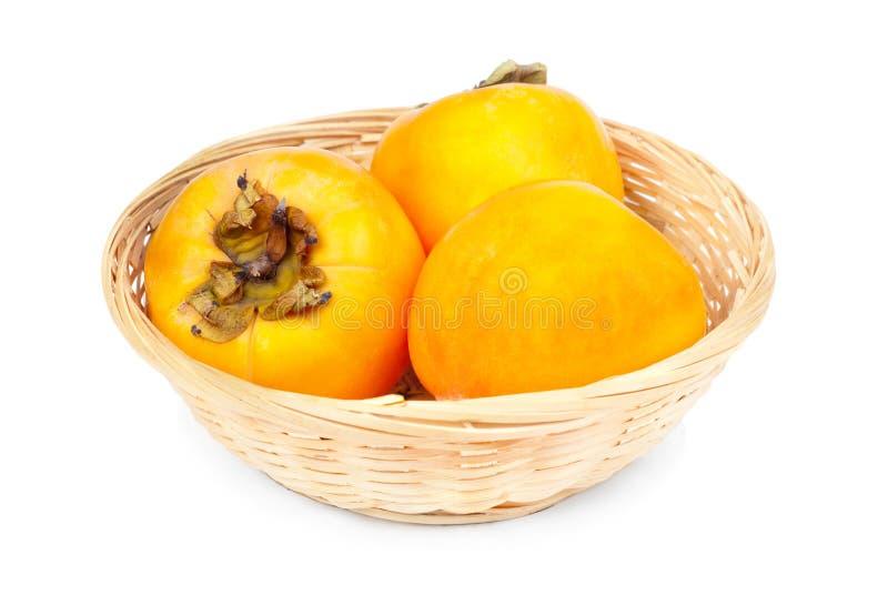 W owocowym koszu Persimmon owoc obraz royalty free