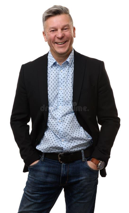W połowie starzeję się biznesowego mężczyzna ono uśmiecha się zdjęcia royalty free