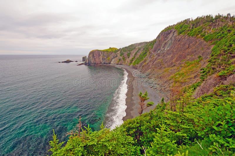 W Popołudniowych chmurach ocean Zatoczka obraz stock