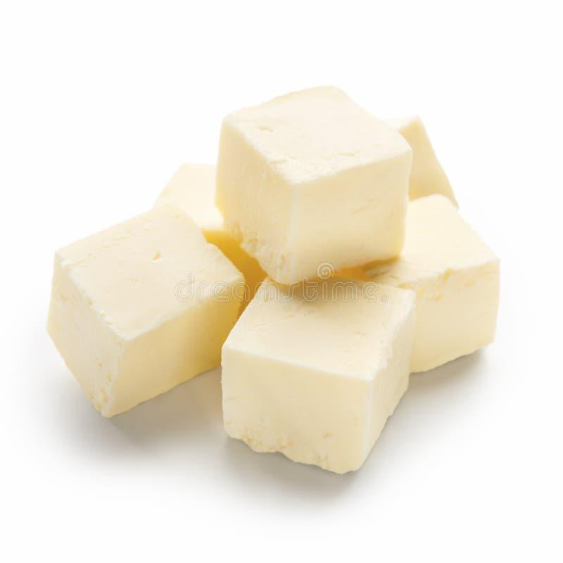 W?rfel von Butter auf Wei? stockfotos