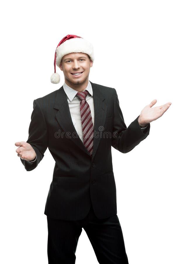 W Santa kapeluszu młody uśmiechnięty biznesmen obraz royalty free