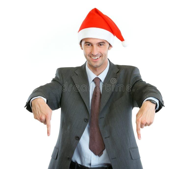 W Santas target1114_0_ kapeluszowy w dół uśmiechnięty biznesmen zdjęcia stock