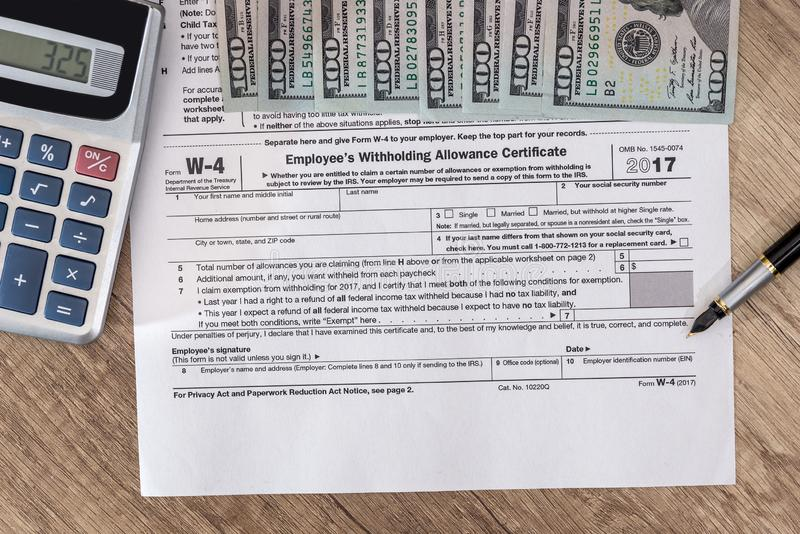 W4 tax form with money. And pen royalty free stock images