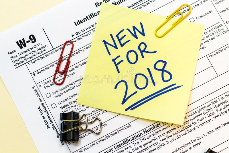 W9 Tax Form New for 2018 Concept. A W9 tax form with New for 2018 written on a sticky note royalty free stock photos