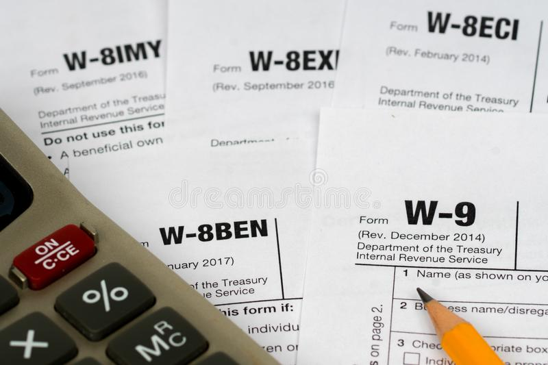 W-9 and w-8ben tax forms stock images