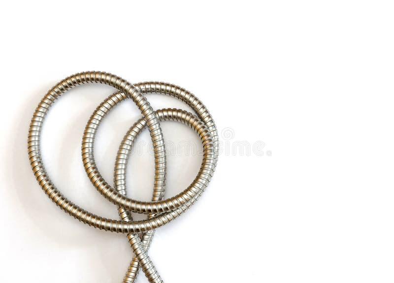 W zawiły sposób kształt tworzył elastycznego metalu wężem elastycznym fotografia stock