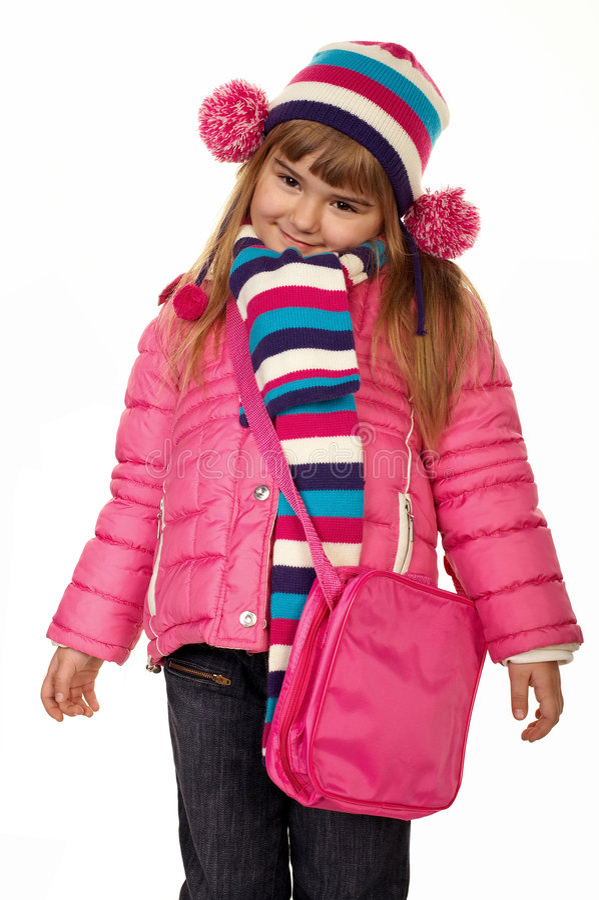 W zima urocza mała dziewczynka odziewa zdjęcie royalty free