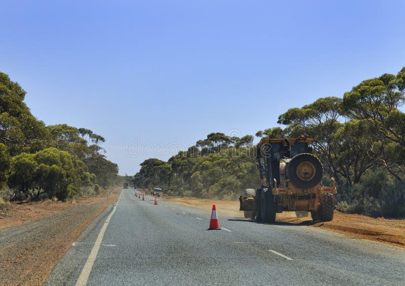 WA-roadworkstraktor arkivbild
