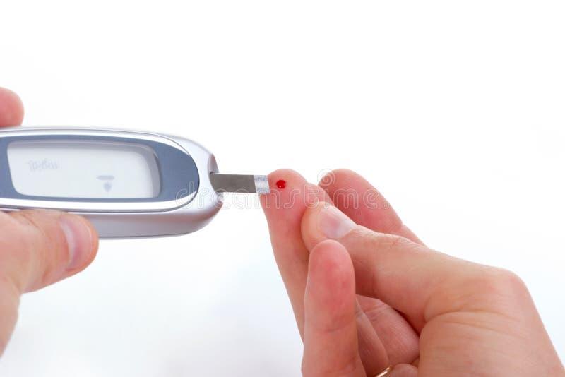 Waagerecht ausgerichtete Blutprobe der Glukose lizenzfreie stockbilder