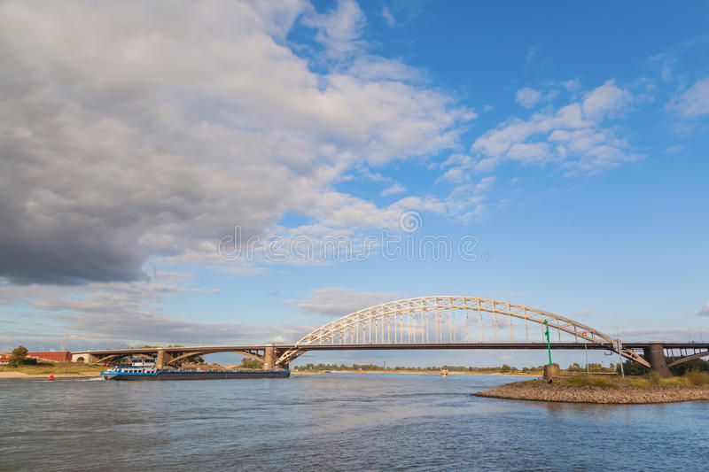 Waal bridge with blue sky and cloud royalty free stock photography