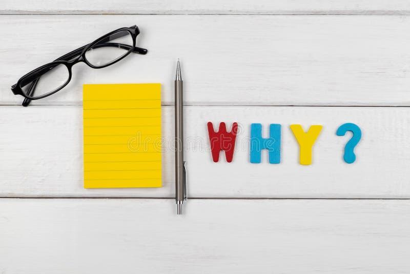 Waarom verwoordend op witte houten achtergrond stock fotografie