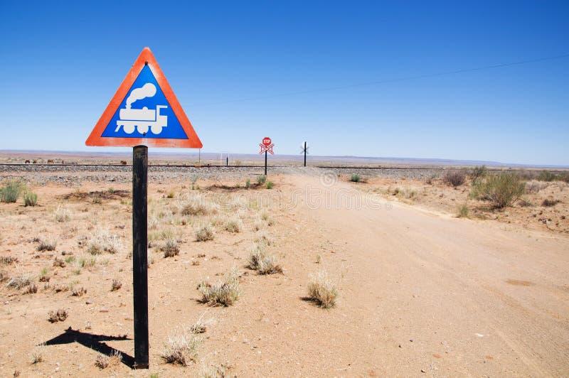 Waarschuwing van verkeersteken - de trein kruist de weg royalty-vrije stock foto's