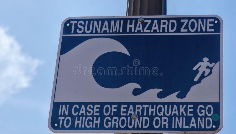 Waarschuwingsbord--De Streek van het Tsunamigevaar stock afbeelding