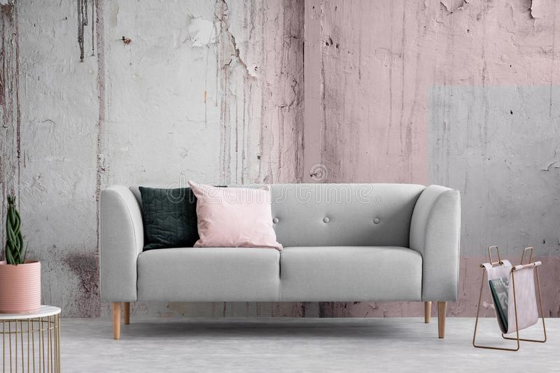 Wabi sabi living room with shabby grey and pink wall, copy space. Wabi sabi living room with shabby grey and pink wall, real photo with copy space royalty free stock images