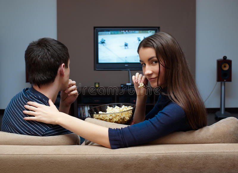 Waching movie. Young couple waching movie on tv royalty free stock images