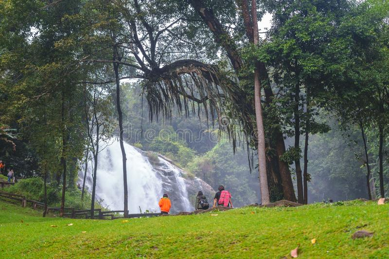 Wachirathan Waterfall with the waterfall and tourist in nature background on December 29, 2017, in Chiang Mai Thailand. stock photos