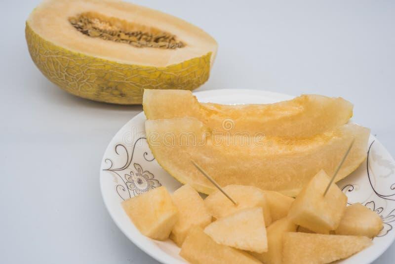 Wachsende reife goldene gelbe Chinese Hami-Melone lizenzfreies stockfoto