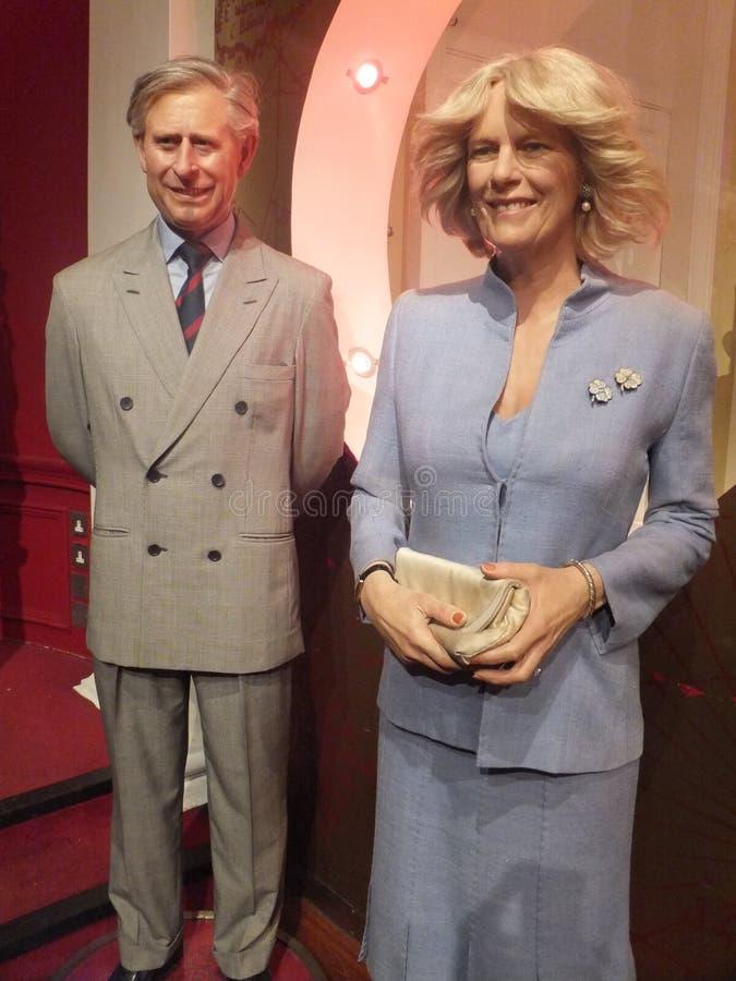 Wachsstatue Prinzen Charles u. Camilla stockbild