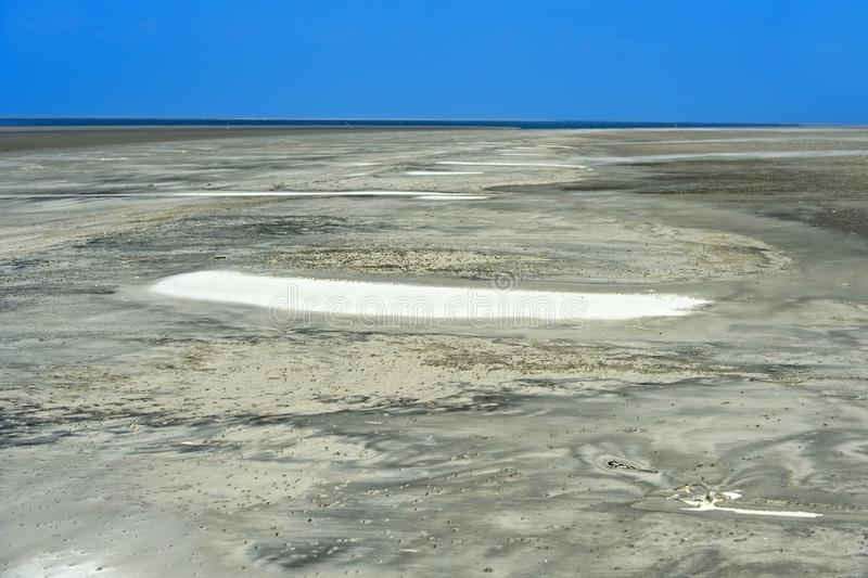 Wadden sea sand shaped by wind and tidal currents. Schleswig-Holstein Wadden Sea National Park, Schleswig-Holstein, Germany royalty free stock images