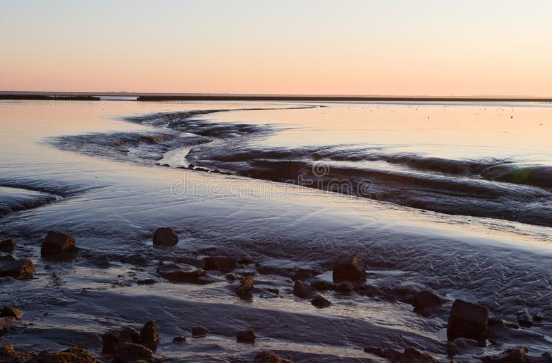 Waddenzee bij Holwerd, Wadden Sea at Holwerd. Waddenzee bij Holwerd; Wadden Sea at Holwerd stock image