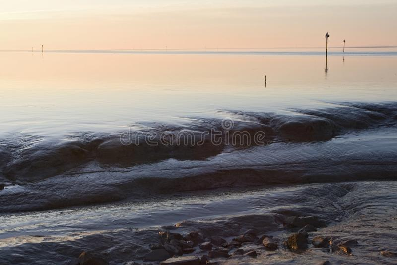 Waddenzee bij Holwerd, Wadden Sea at Holwerd. Waddenzee bij Holwerd; Wadden Sea at Holwerd stock photography