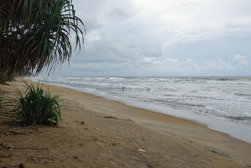 Wadduwa, Sri Lanka - May 08, 2018: Fishermen are fishing on the shore of the tropical ocean. The coast of Sri Lanka stock image