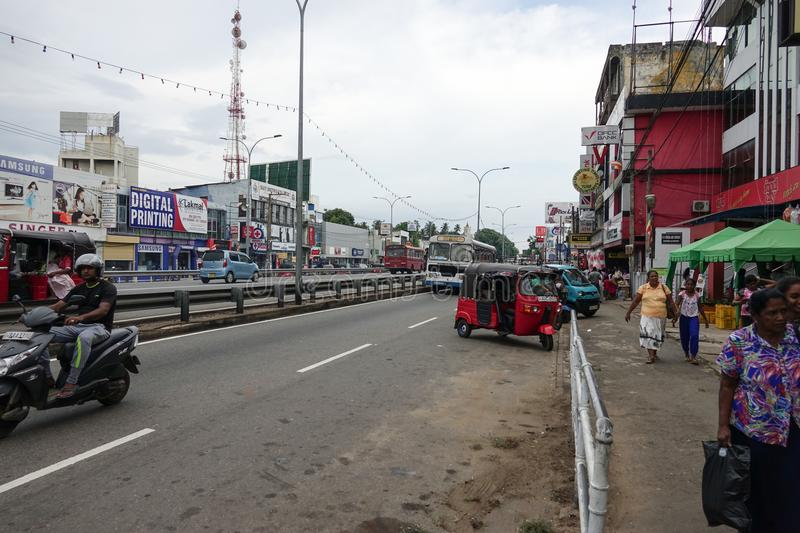Wadduwa, Sri Lanka - May 05, 2018: View of the street Colombo - Galle Main RD in Wadduwa city. Along the street there are many shops and boutiques royalty free stock photography
