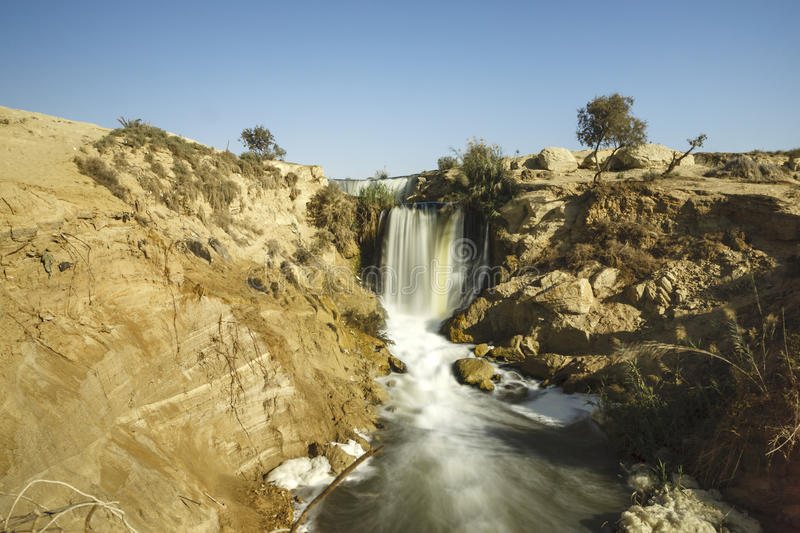 Wadi El-Rayan Waterfalls. The valley of Wadi El-Rayan stretches on an area of 1759 km2, 113 km2 of which are the dominating water body of Wadi El-Rayan lakes stock image