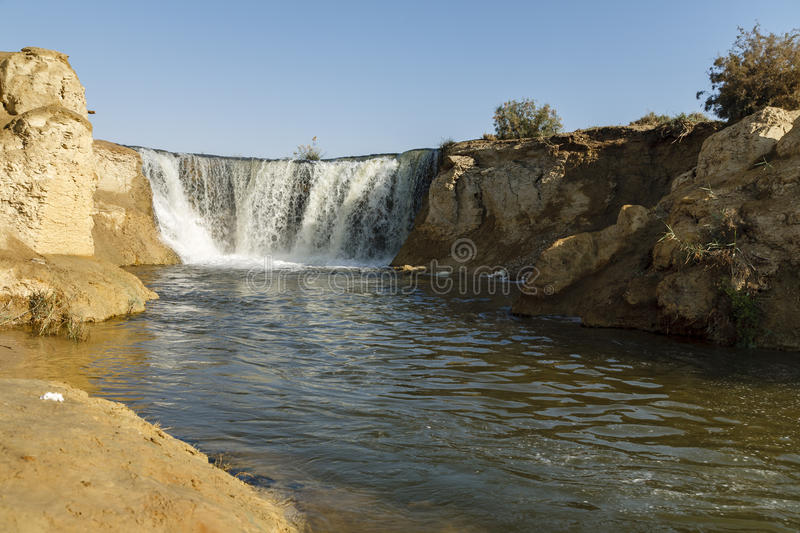 Wadi El-Rayan Waterfalls. The valley of Wadi El-Rayan stretches on an area of 1759 km2, 113 km2 of which are the dominating water body of Wadi El-Rayan lakes stock photo
