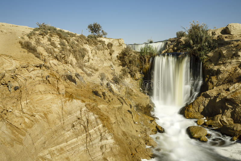 Wadi El-Rayan Waterfalls. The valley of Wadi El-Rayan stretches on an area of 1759 km2, 113 km2 of which are the dominating water body of Wadi El-Rayan lakes stock images