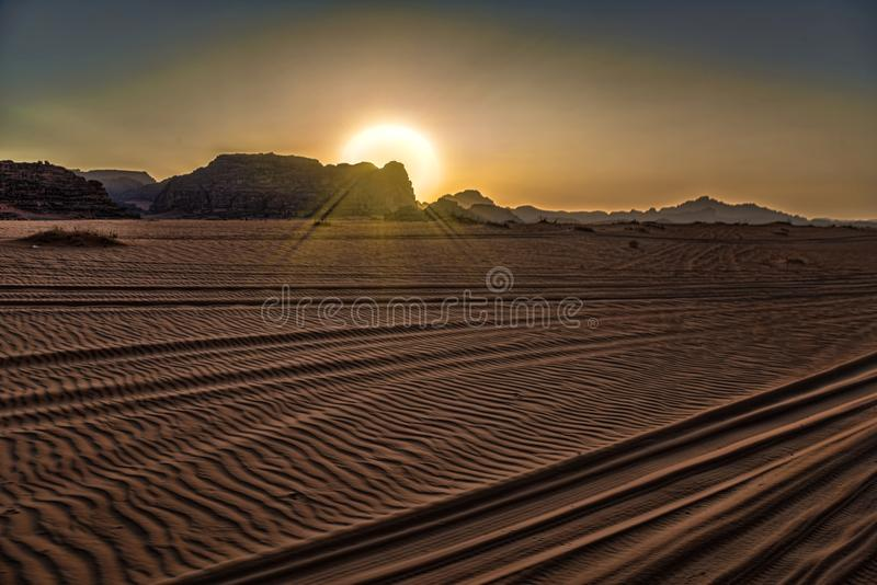 Wadi Rum desert Jordan 17-09-2017 View from a moving jeep over an enchanting desert landscape at sunset, which partly undergoes a. High mountain. In the stock image