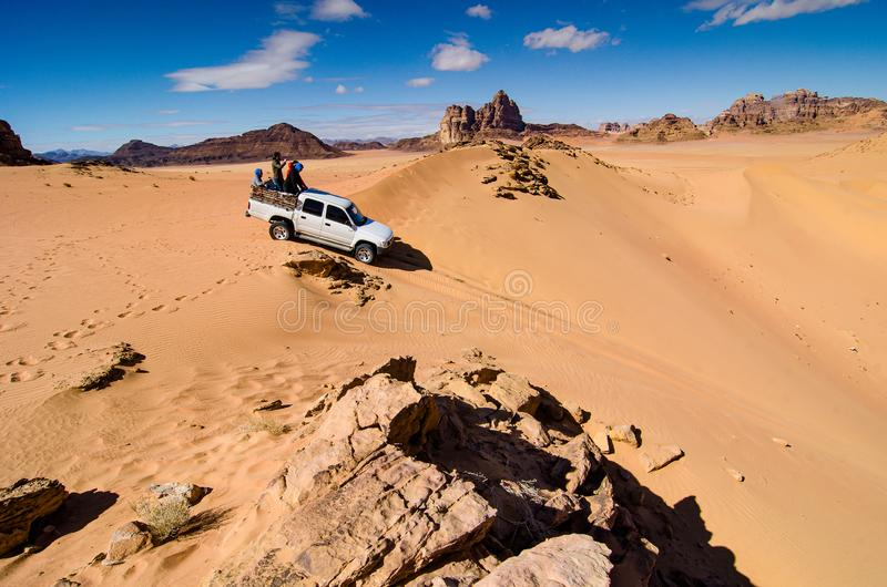 Wadi Rum, Jordan - January 26, 2012. Tourist on offload car in desert.  stock photography