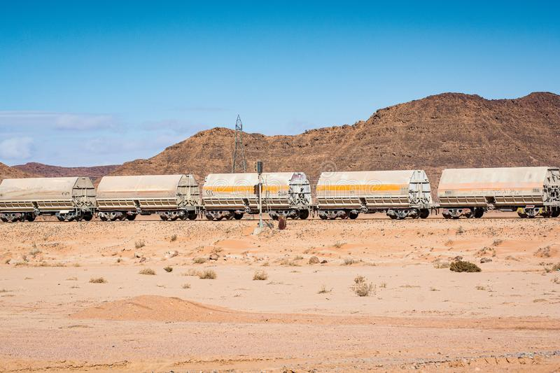 Wadi Rum, Jordan - January 26, 2012. Train of mine in desert.  royalty free stock photo