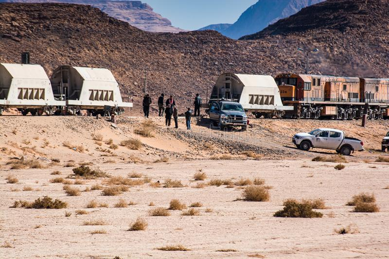 Wadi Rum, Jordan - January 26, 2012. Train of mine in desert.  royalty free stock images