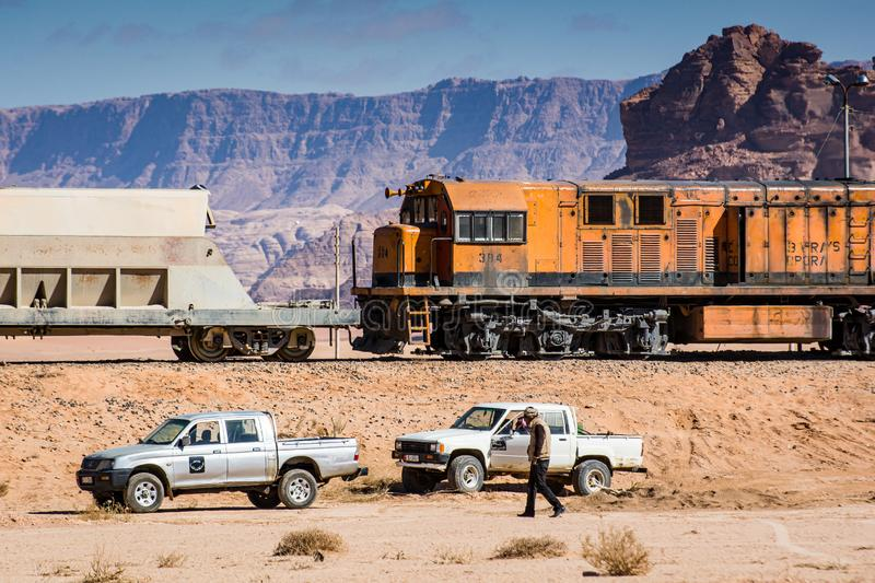 Wadi Rum, Jordan - January 26, 2012. Train of mine in desert.  stock photo