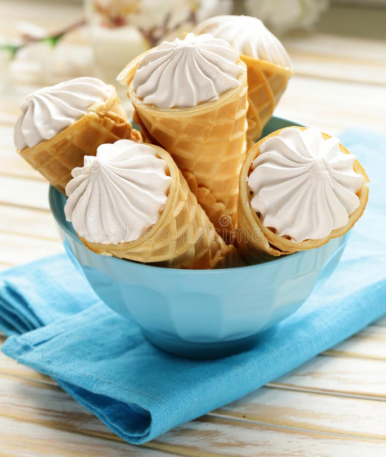 wafer cone filled with vanilla cream stock photos