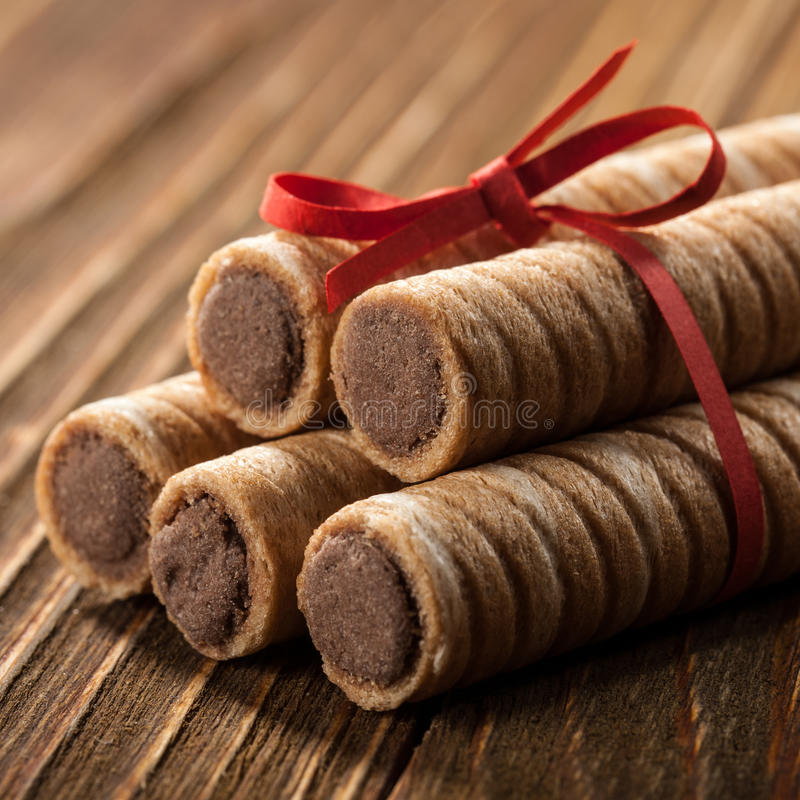 Wafer rolls. On wooden table stock photography