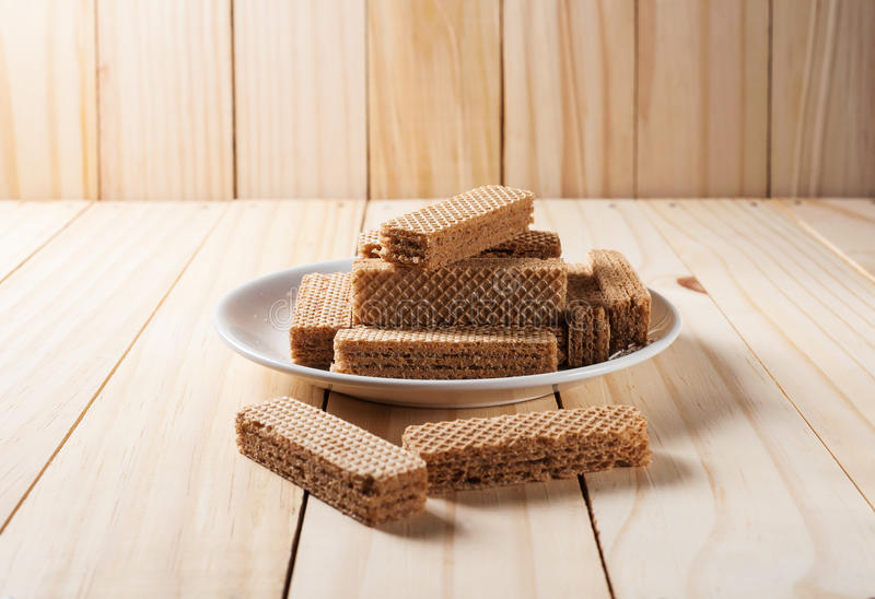 Wafers with chocolate in white plate royalty free stock photo