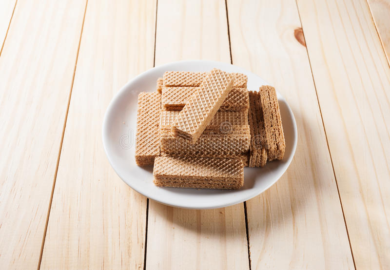 Wafers with chocolate in white plate stock photo