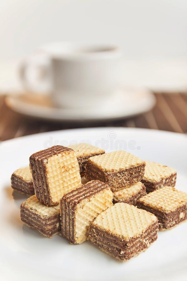 Wafers cubes with chocolate. on White plate royalty free stock images