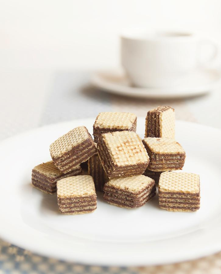 Wafers cubes with chocolate. on White plate royalty free stock photography