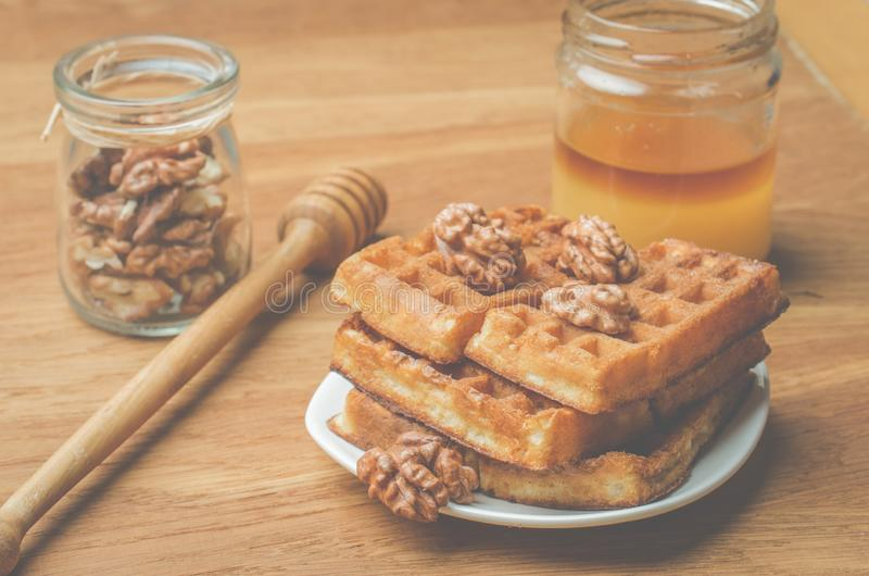 Wafers. Home made pastries, wafers and walnut with honey on a wooden background royalty free stock images