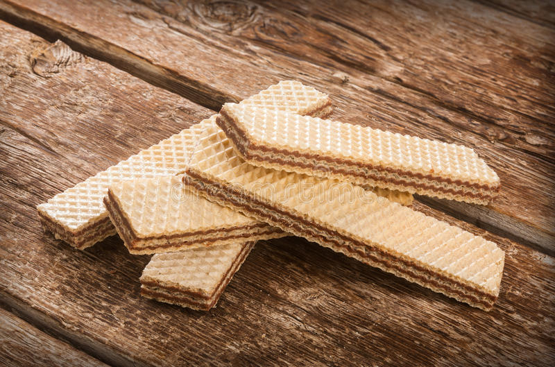 Wafers on wooden table. stock photos