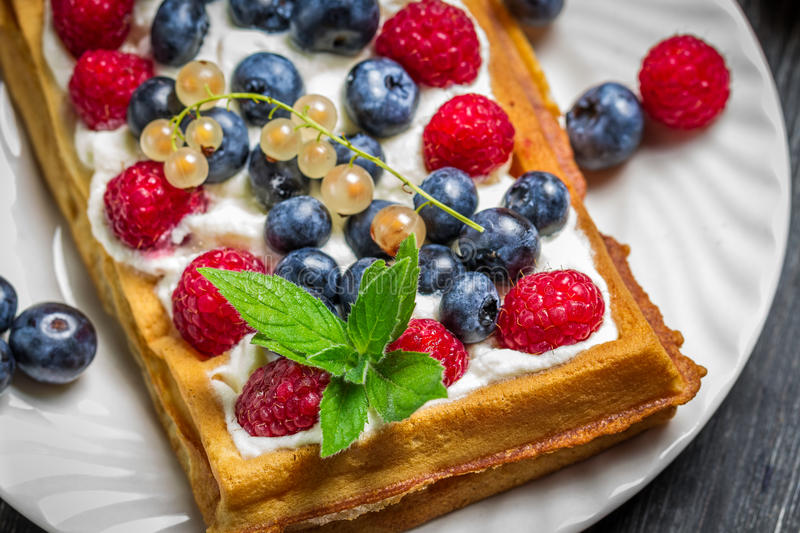 Waffels with cream and berry fruits stock photos