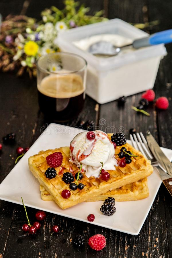 Waffle with berries and ice cream stock photos