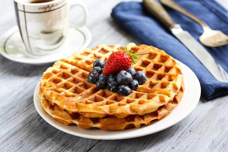 Waffle Breakfast with blueberries. Warm Waffle Breakfast with blueberries made in a home kitchen stock photography