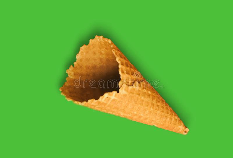 Waffle cone for ice cream on a green background with copy space for insertion or decoration of text, logo or wording, concept of stock images