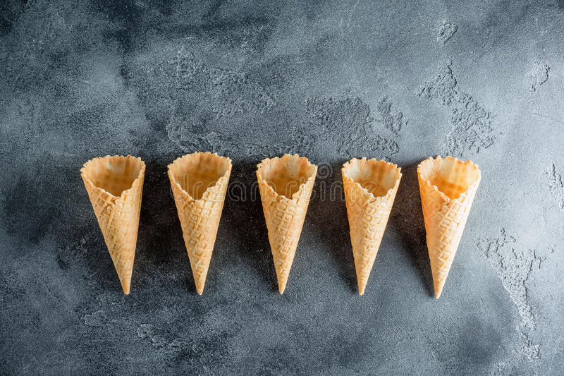 Waffle cones on grey background. Summer concept. Flat lay, top view stock images