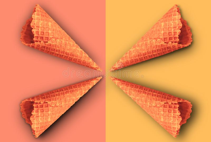Waffle cones for ice cream on a yellow and pink background with copy space for insertion or decoration of text, logo or wording, royalty free stock photography